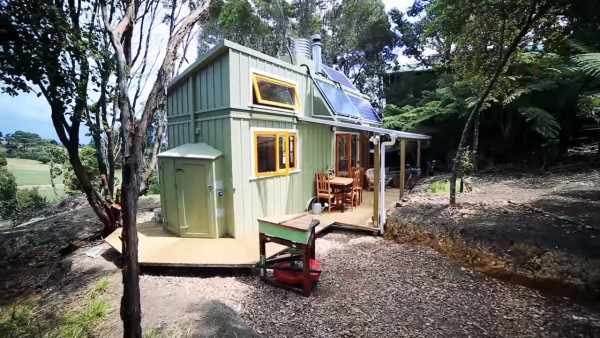 woman-solar-offgrid-tiny-home-002